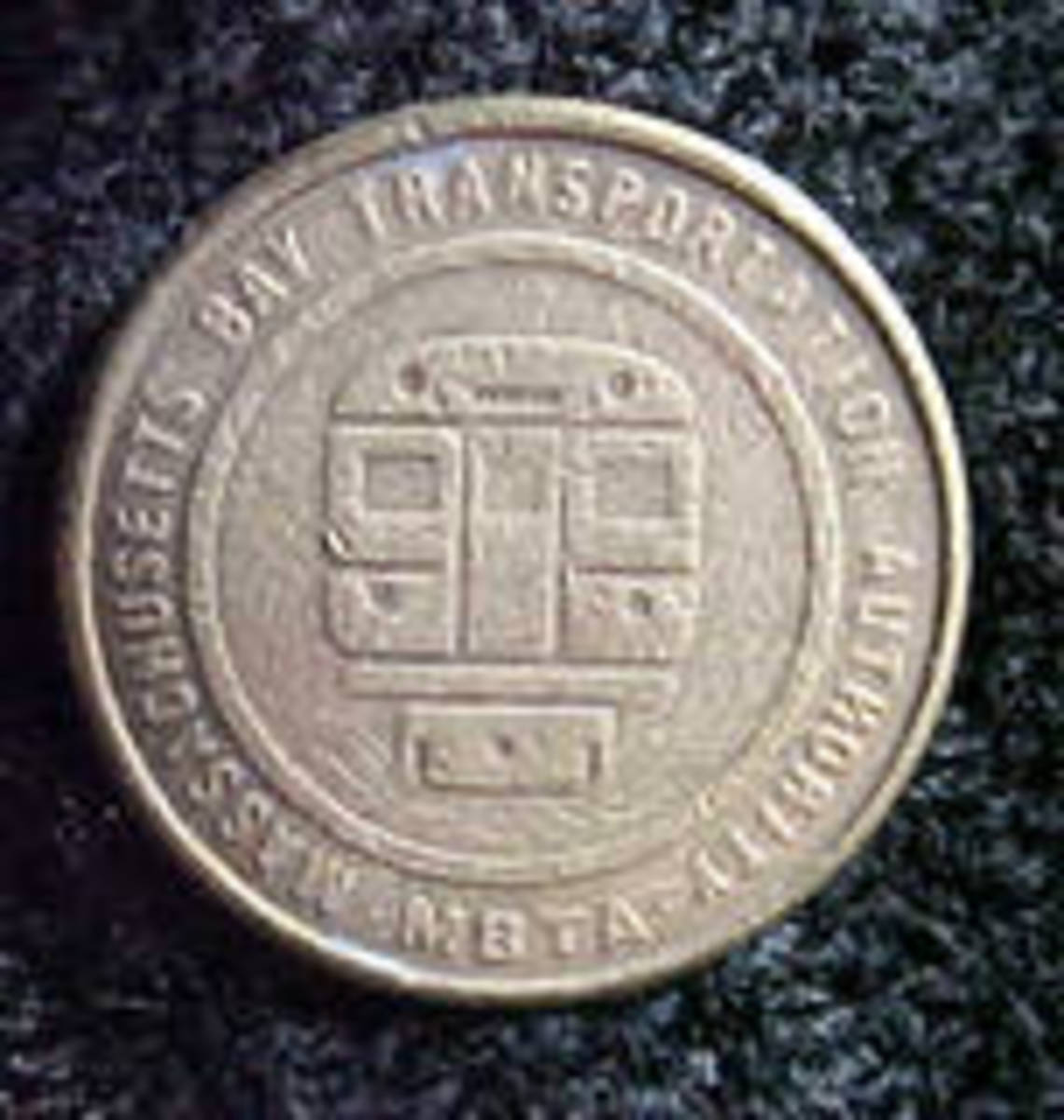 This is a fine example of an MBTA coin.