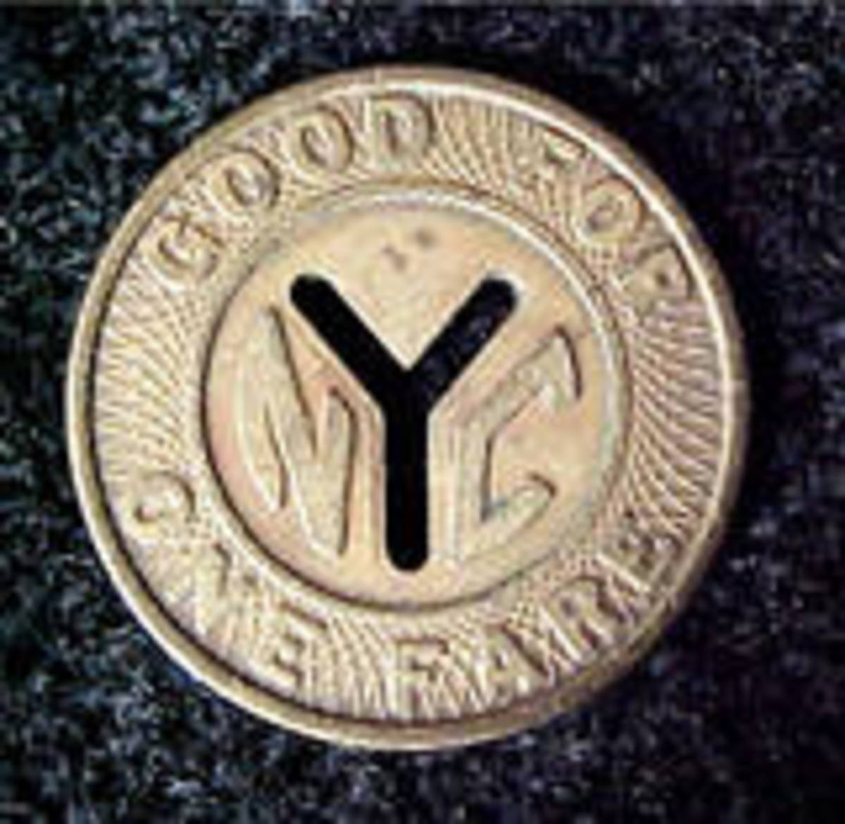 This is an example of the larger size of NYC's subway transit coin.