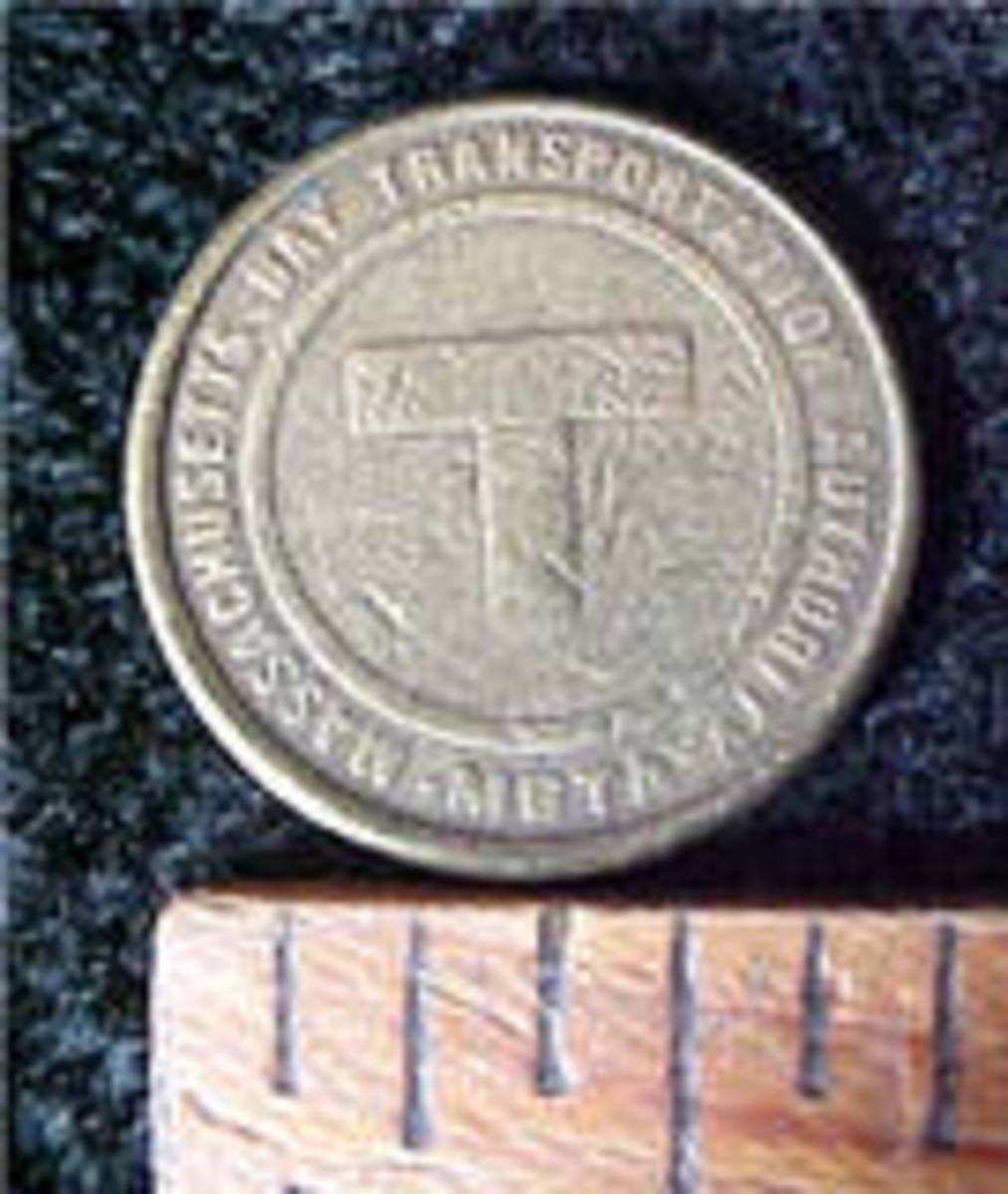 This is the reverse side of the Massachusetts transit coin, measured to designate scale.