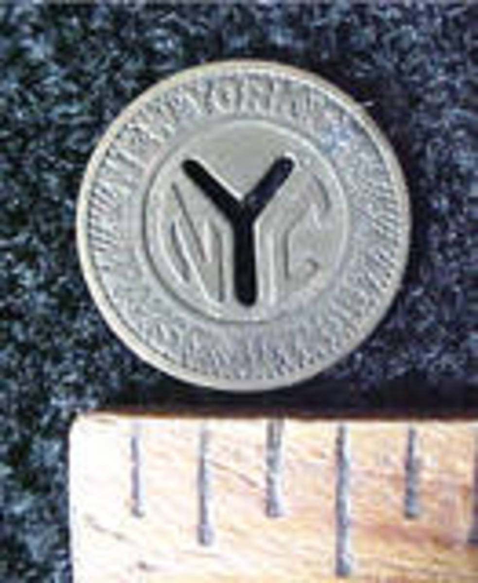 This is an example of the smaller version of the NYC subway coin.