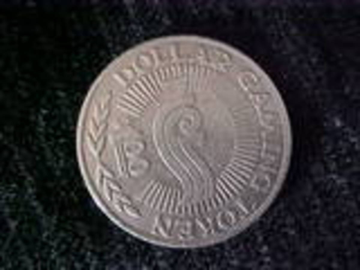 "This is the reverse side which shows it is a ""Dollar Gaming Token."""