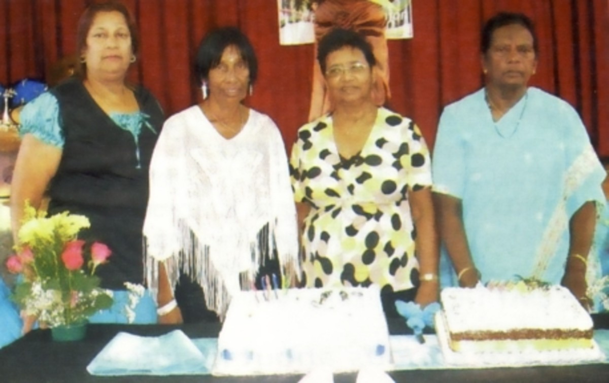 "Dolly Naidu, Joyce Pillay, Jay Govender and Sheila Pillay with the cakes for the Govender family reunion in April 2010. Photo ""You"" Magazine"