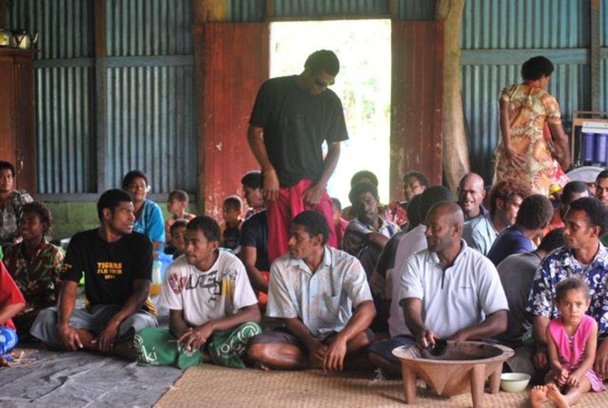 Villagers in Fiji prepare for a dancing celebration