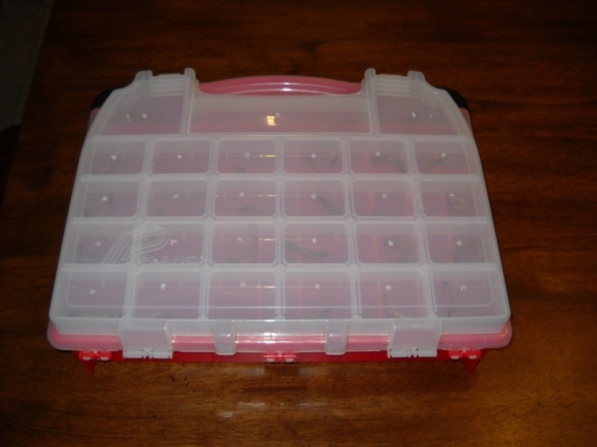 Plano Molding 5231 Double Cover Stow N Go Organizer with holes poked in top and superworms inside.
