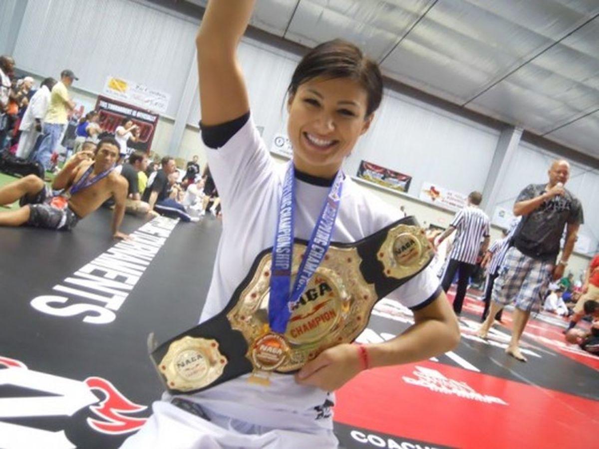 Monique with her NAGA Championship belt.