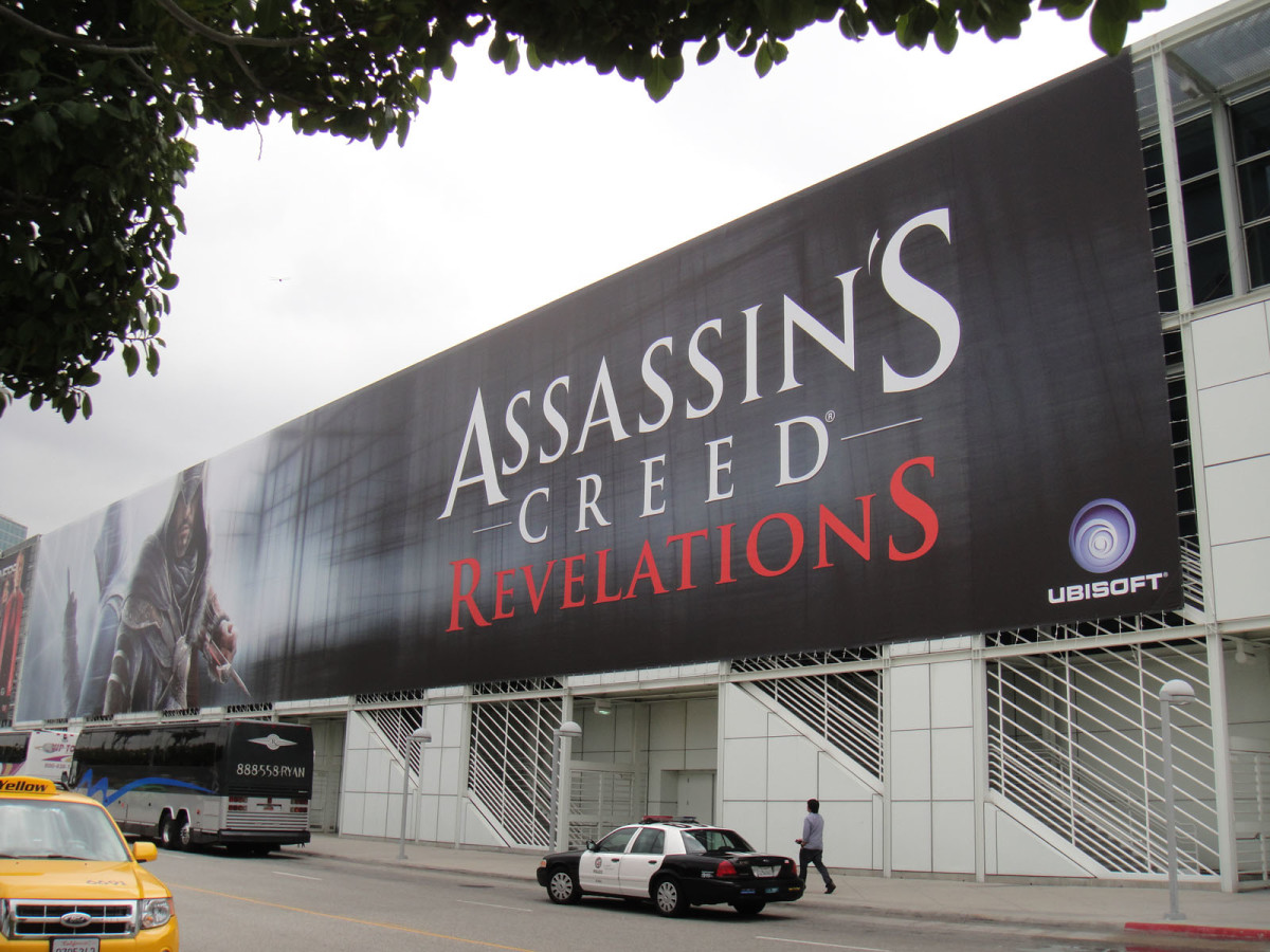 An Assassin's Creed billboard at the E3 conference, 2011.