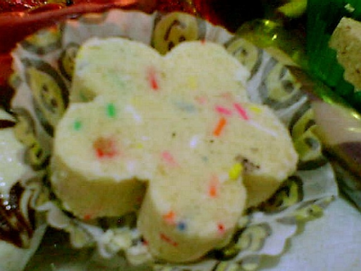 flower-shaped polvoron with colored sprinkles placed in fluted paper cup