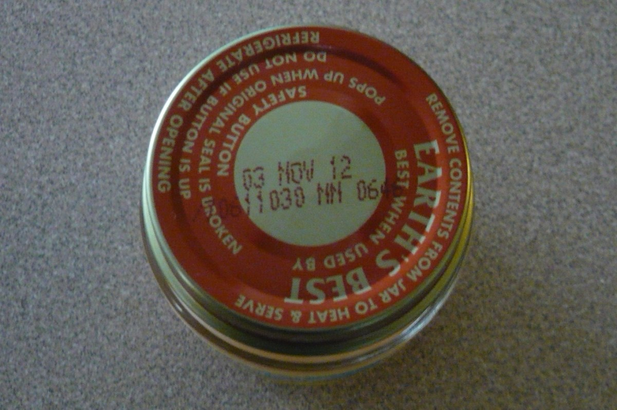 As you can see, this moldy jar of Earth's Best baby food was not even close to being expired (we bought it on 04/19/2011).