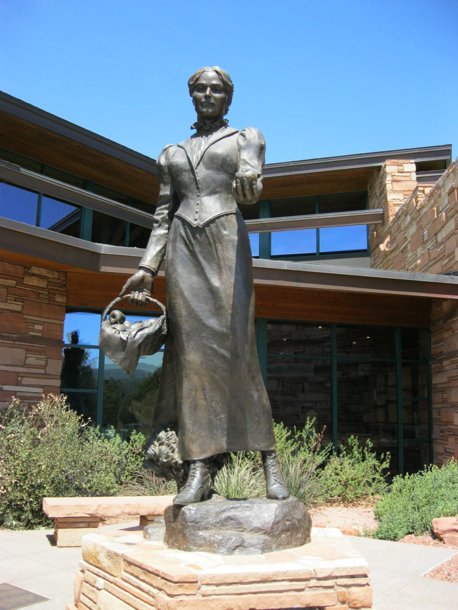 Bronze Sculpture of Sedona Schnebly  by artist Susan Kliewer in front of Sedona's Library