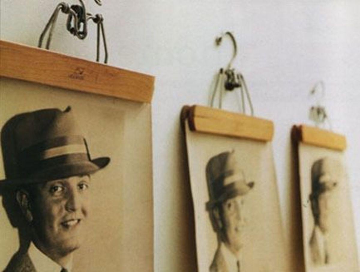 DIY Wall Art - Pant Hangers Hold Art via Curbly