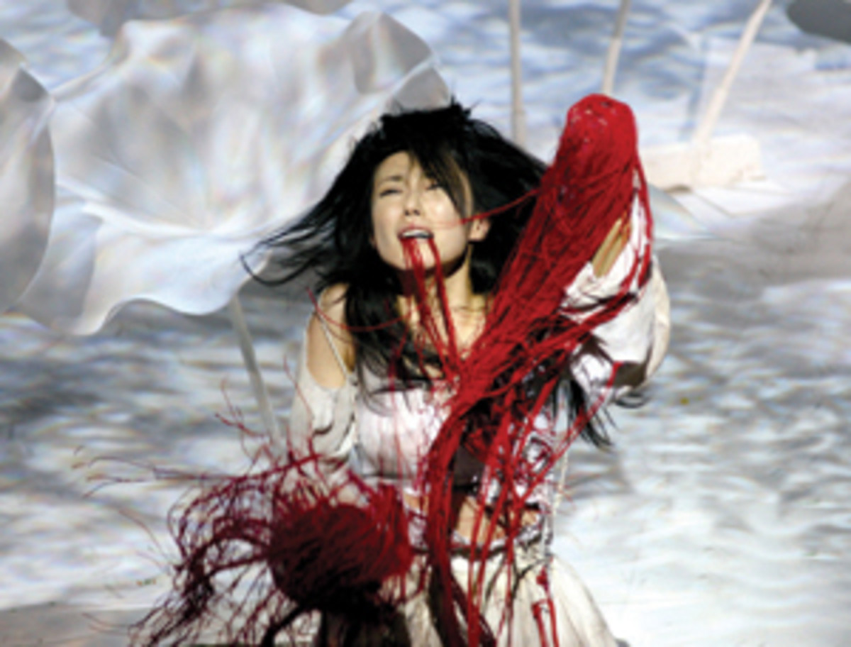 The mutilated Lavinia, whose wounds are represented with ribbons of blood in Ninagawa's 2006 Titus