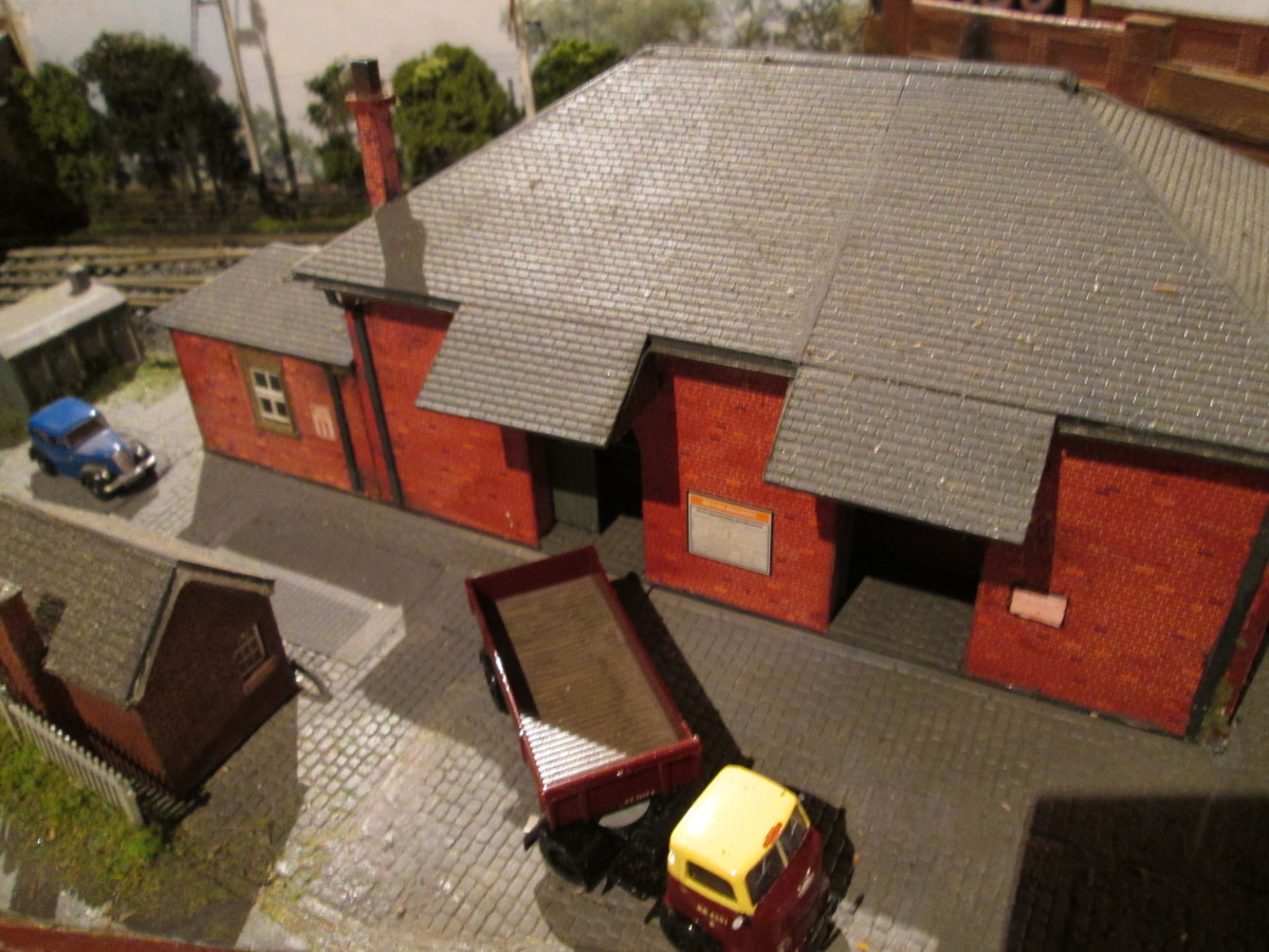 Goods shed - straightforward kit you might say. Wrong. The basic kit is out of the packet, the loading bays and struts are add-ons, as is the slate roof (Wills'), the chimneys modified, goods platform arrangement, doors and goods crane also extras