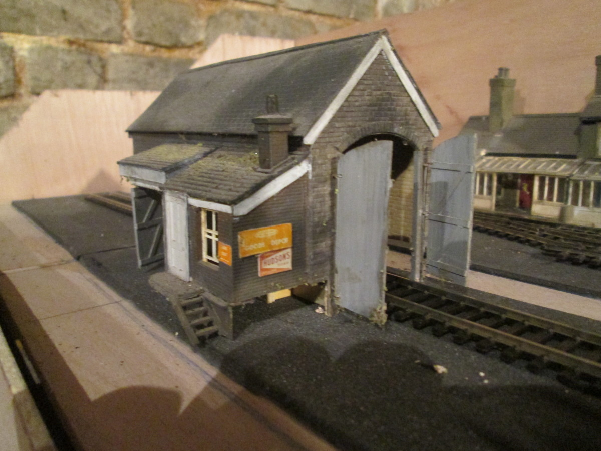 The goods shed from the same layout, using the same detailing sources, split pins and brass wire for door 'hinges', Ratio chimney. The door was made up using strip planking.