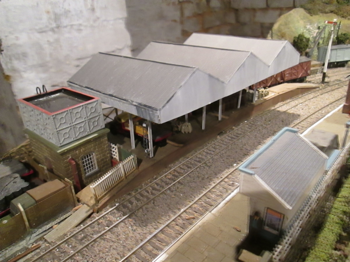 Goods depot roof was bought assembled. Pillars, side awnings and laddering applied to fit the location. The water tower and platform shelter are from Hornby's Skaledale range based on Goathland on the NYMR