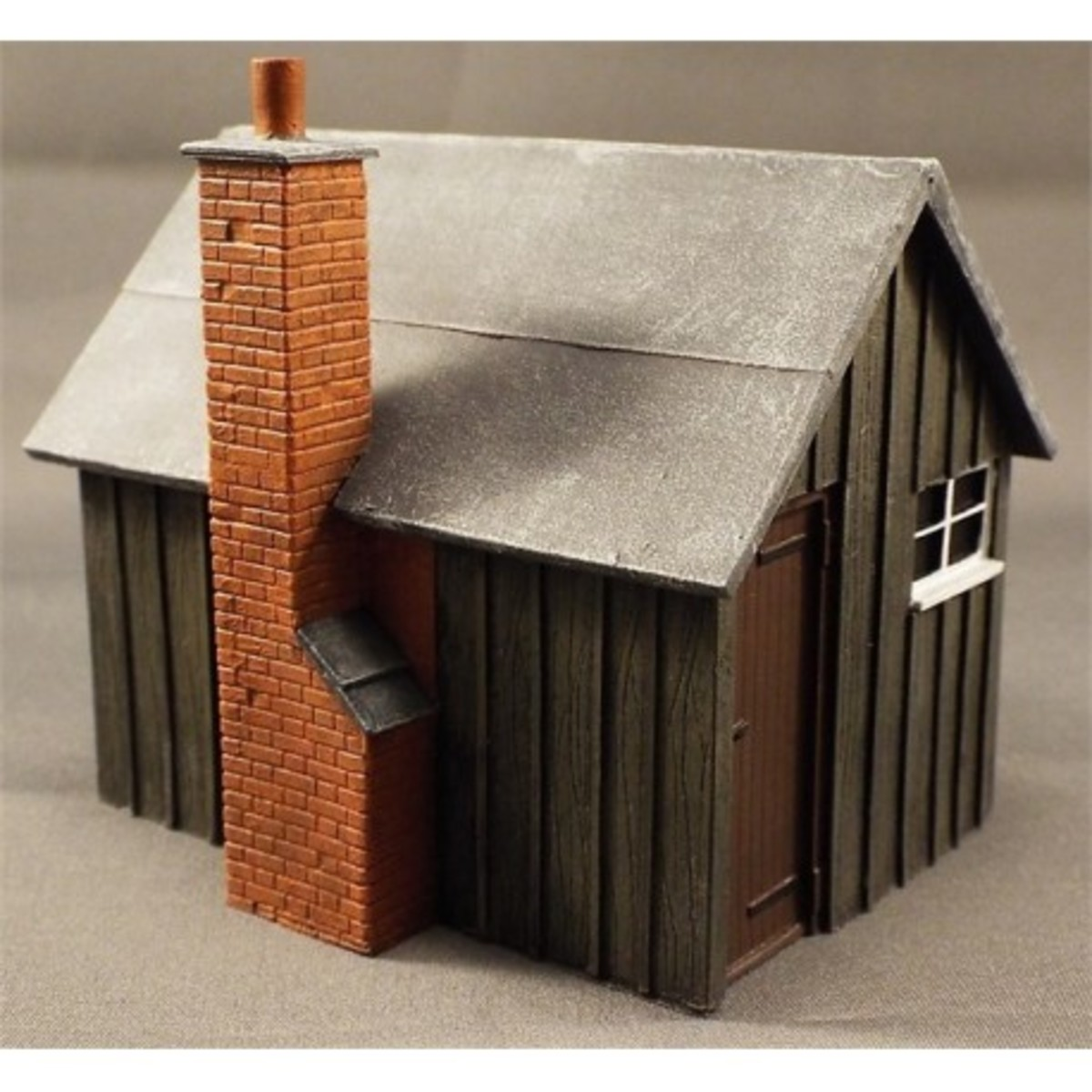 Another Ratio product you'd find anywhere from Penzance to Perth, a sleeper-built platelayer's hut with brick chimney stack. Go to town on this one, 'distress' it, make it a ruin if you like, on a modern layout or paint it as new in period setting