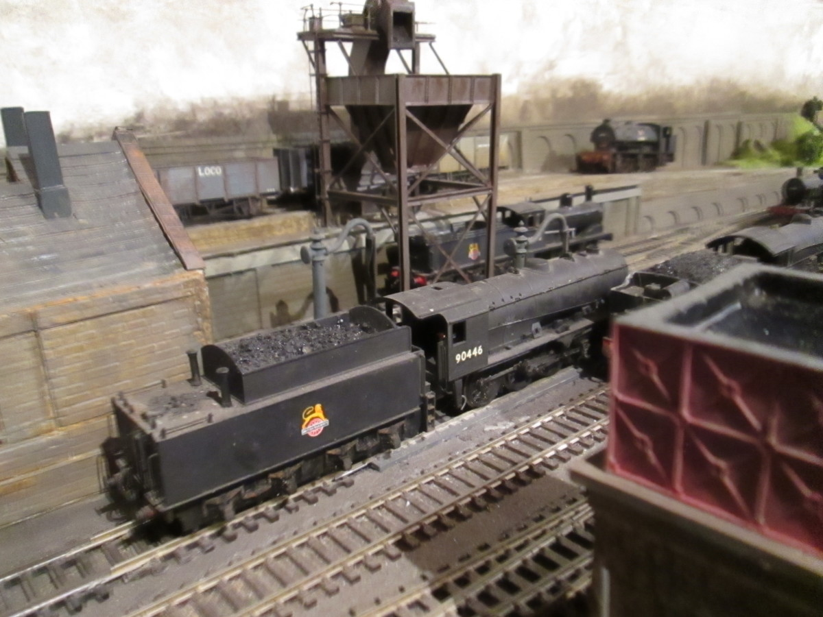 Ayton Lane's coaling tower kit needed modifications to fit in its location. Right foreground: Hornby 'Skaledale' water tower based on Goathland; left is entry to scratch-built two-road loco shed, Mike's Models water cranes; track now cinder-ballasted