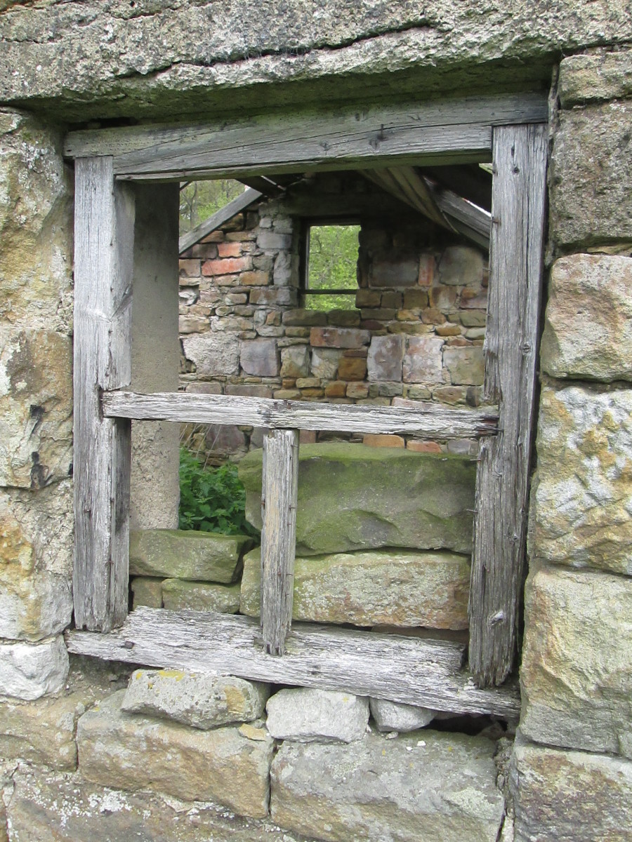 It doesn't look as if there was ever anywhere to put feed and the doorway's too narrow or low to lead animals such as ponies