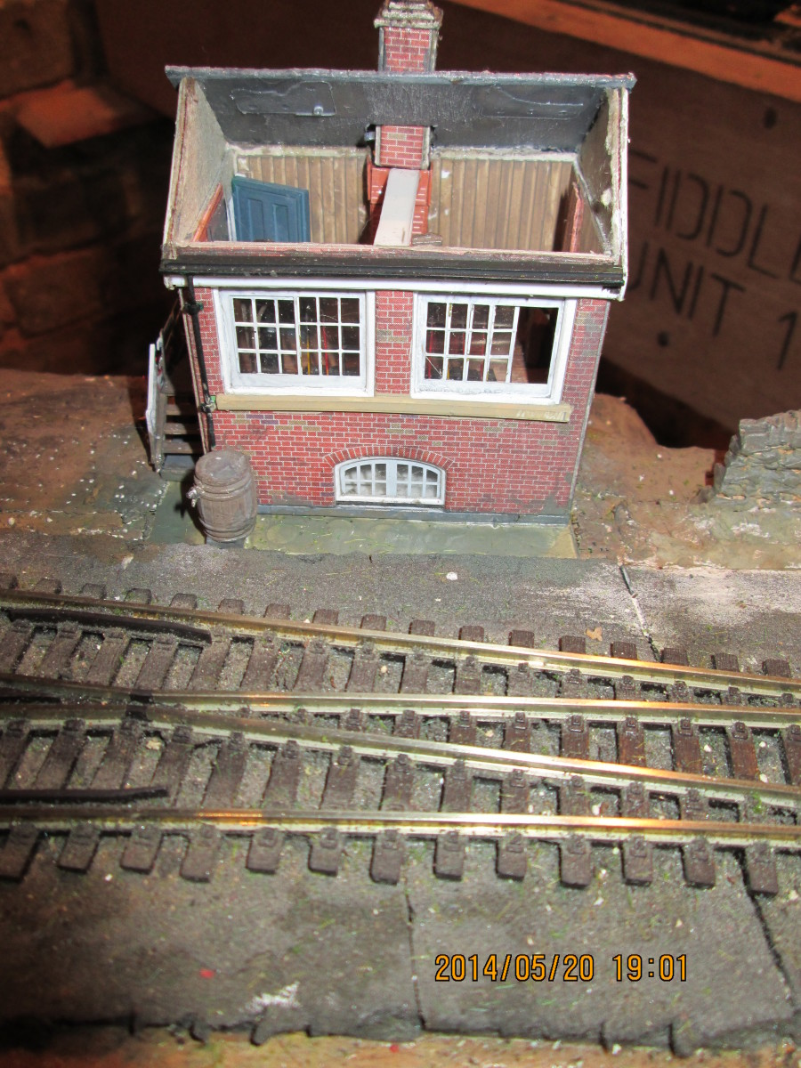 What started out as a Metcalfe card kit (free with Hornby Magazine) became a hybrid with elements from a Ratio signal box kit, D&H NER window etchings, Evergreen siding painted to look like wood planking on floor and walls and Wills slate roof