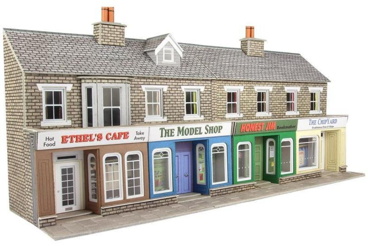 The Metcalfe low-relief terraced shops and flats in stone finish completes a layout where a spare corner needs to be filled