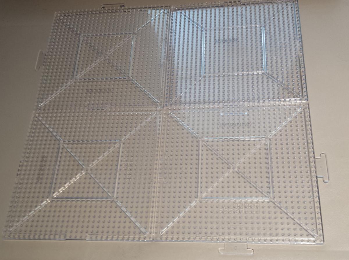Four standard perler boards interlocked together.