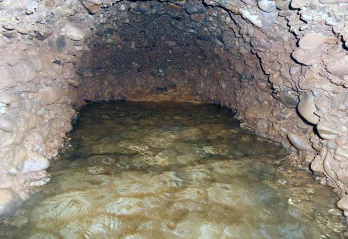 Flooded tunnel beneath one of the pyramid-shaped mountains
