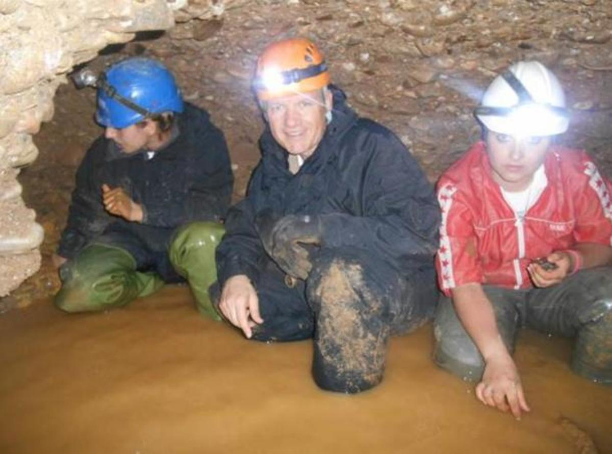 Osmanagich (center) ankle deep in tunnel water