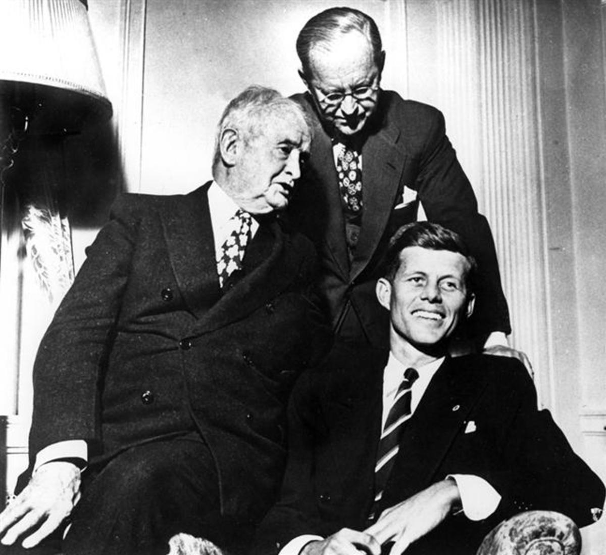"""3 Generations of Kennedys: John Francis """"Honey Fitz"""" Fitzgerald (left), his son-in-law Joe Kennedy (standing) and his grandson John Fitzgerald Kennedy (seated) photo courtesy of historyguy.com"""