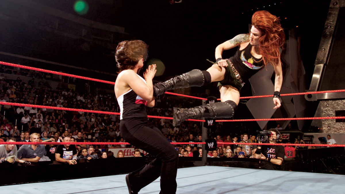 Lita with the dropkick to Molly Holly