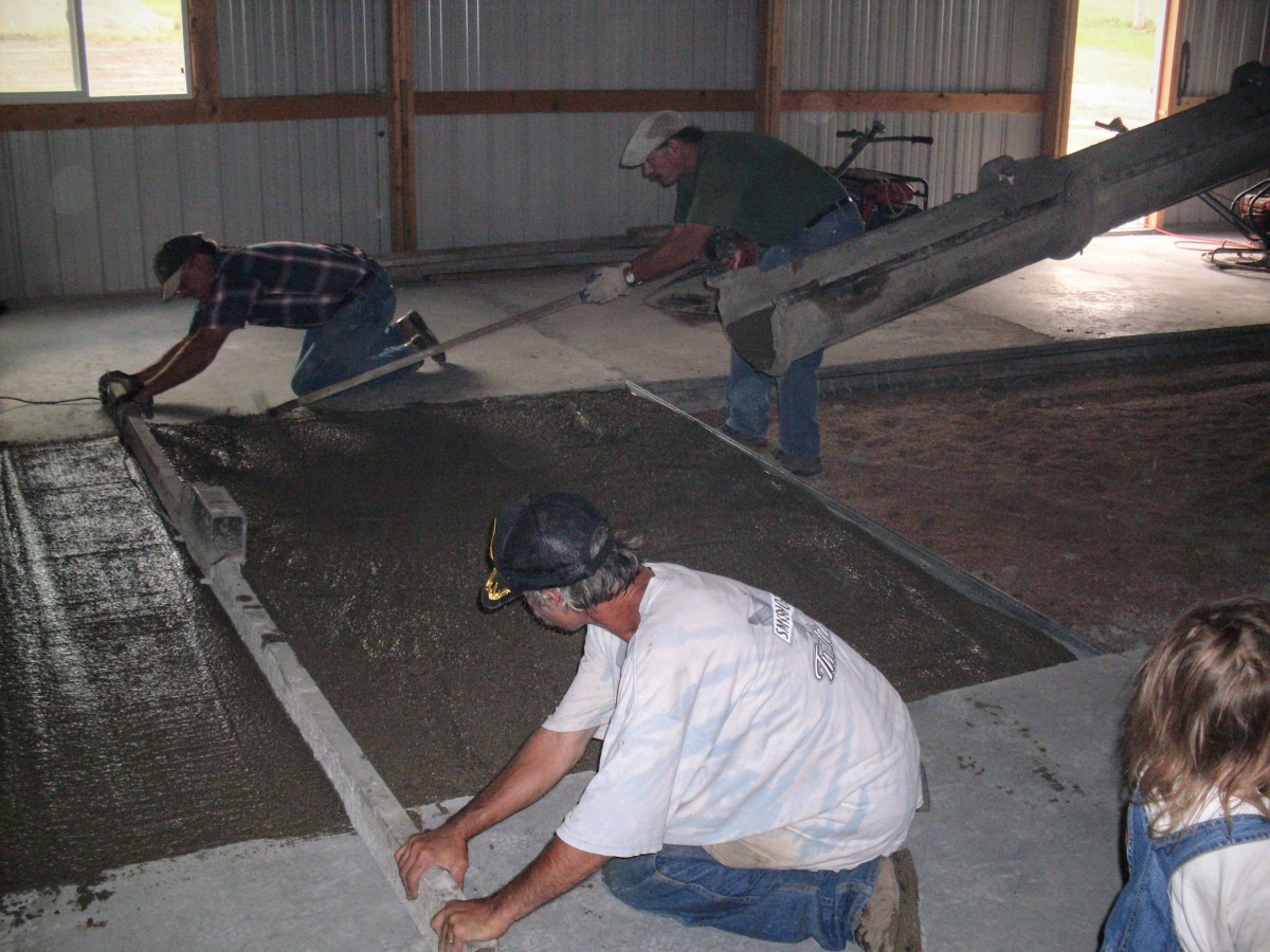 They go over the slab several times, giving more attention to some places than others. Holes or dips are filled in with shovelfuls of concrete, or a drag is used to move concrete from high spots into low ones.