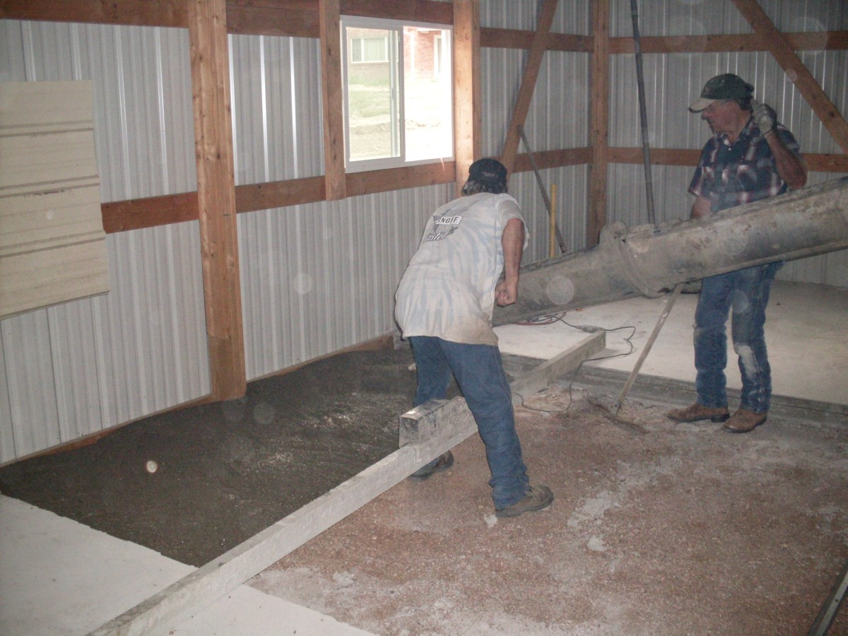 We had covered the window nearest the chute with a piece of sheet metal, in case of accidents in handling the chute or other equipment. That is a power screed lying across the section.