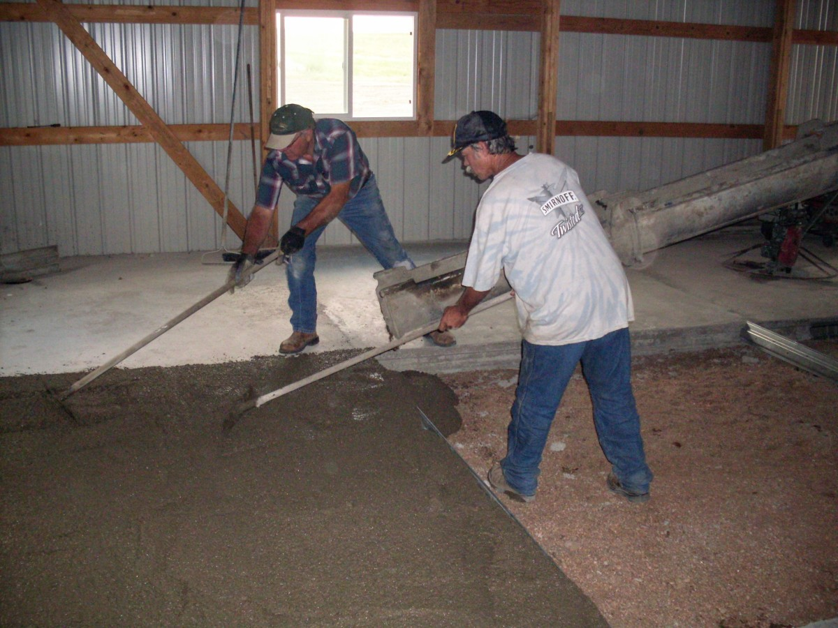 My husband and his co-worker use drags to help apportion and smooth the concrete