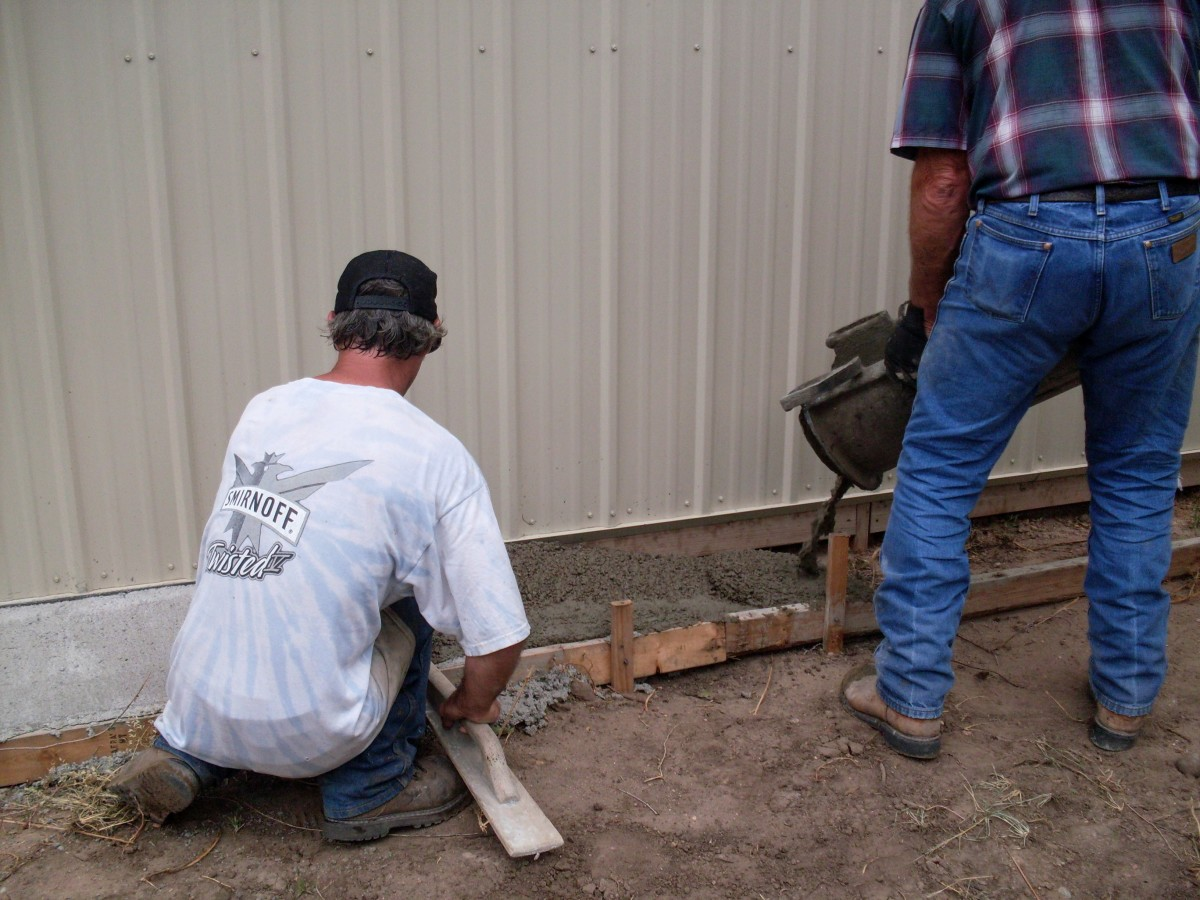 Holes are drilled for extra stabilization of the ground next to the building, as runoff is heavy here.