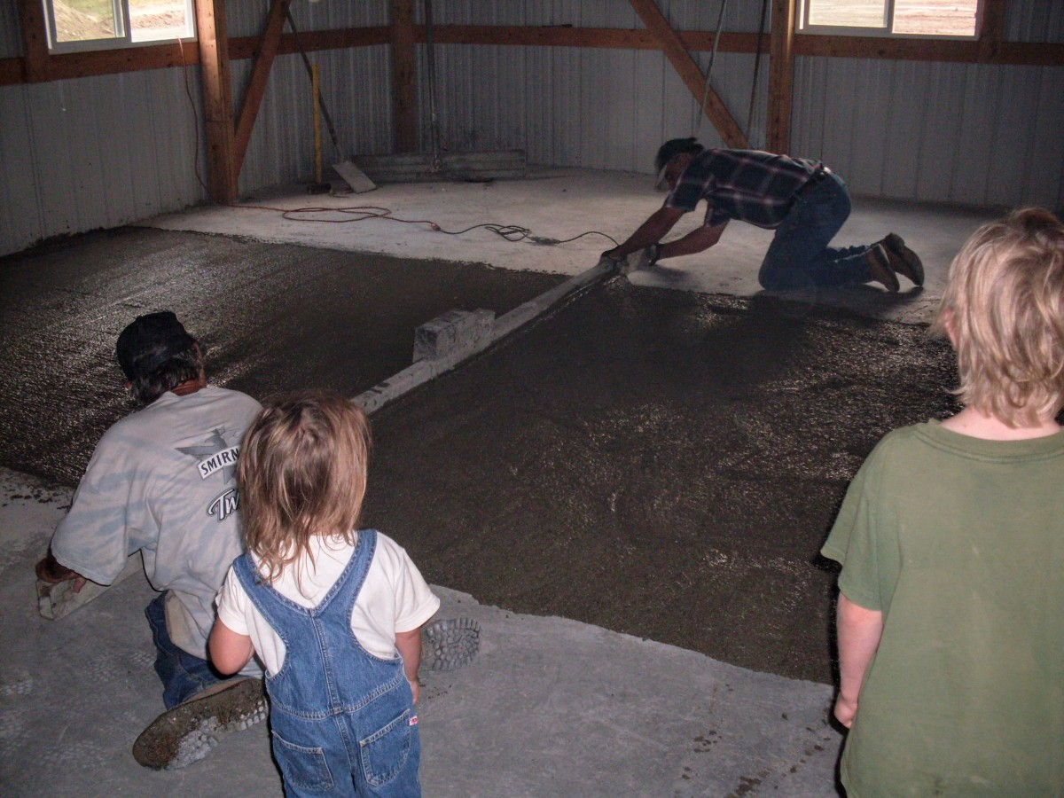 The men don't have to use a lot of muscle with this screed, as it is a power screed, and shakes the concrete into place. But they do need to be watchful and consistent, or the concrete may wind up slightly humpy.