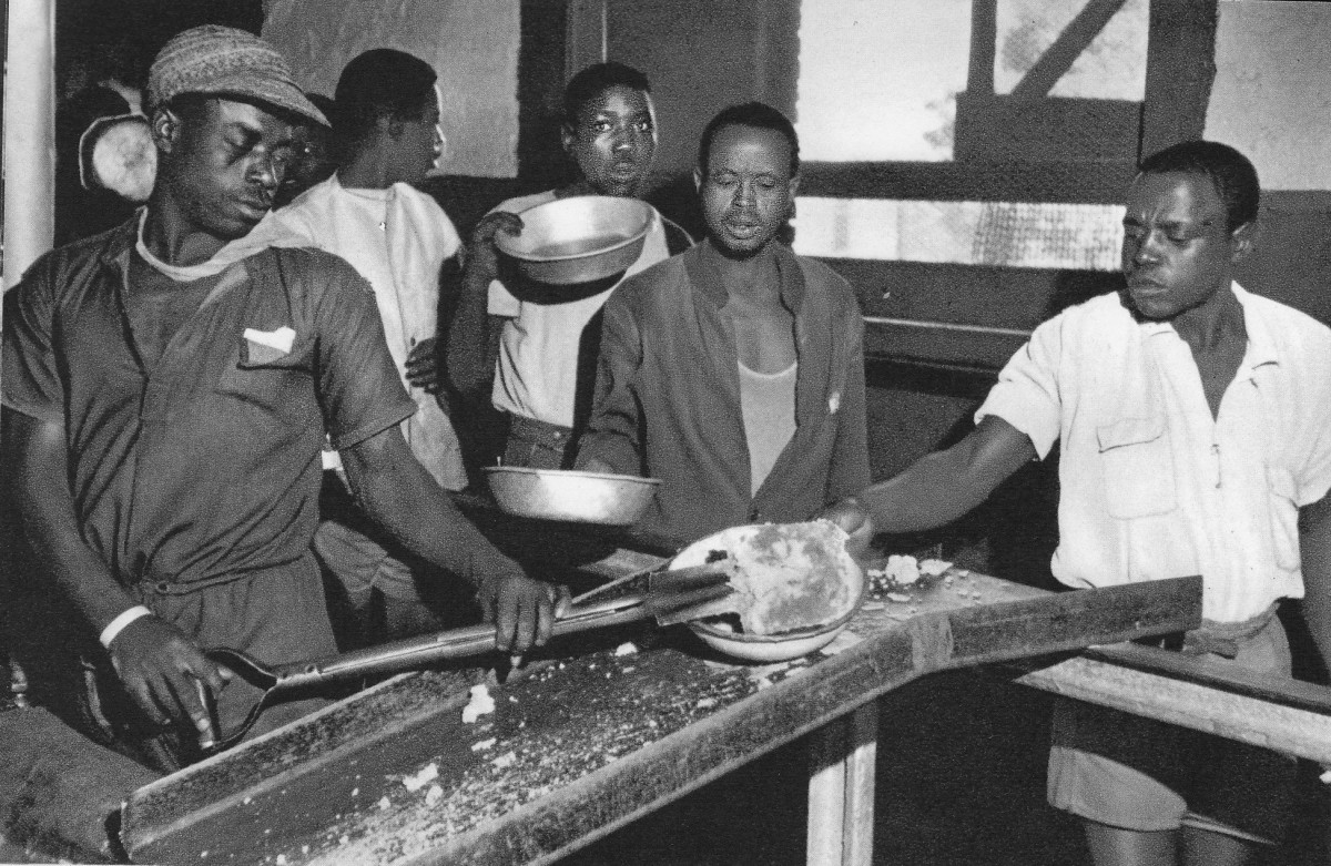 Food being literally dished-out with a shovel to miners from underground