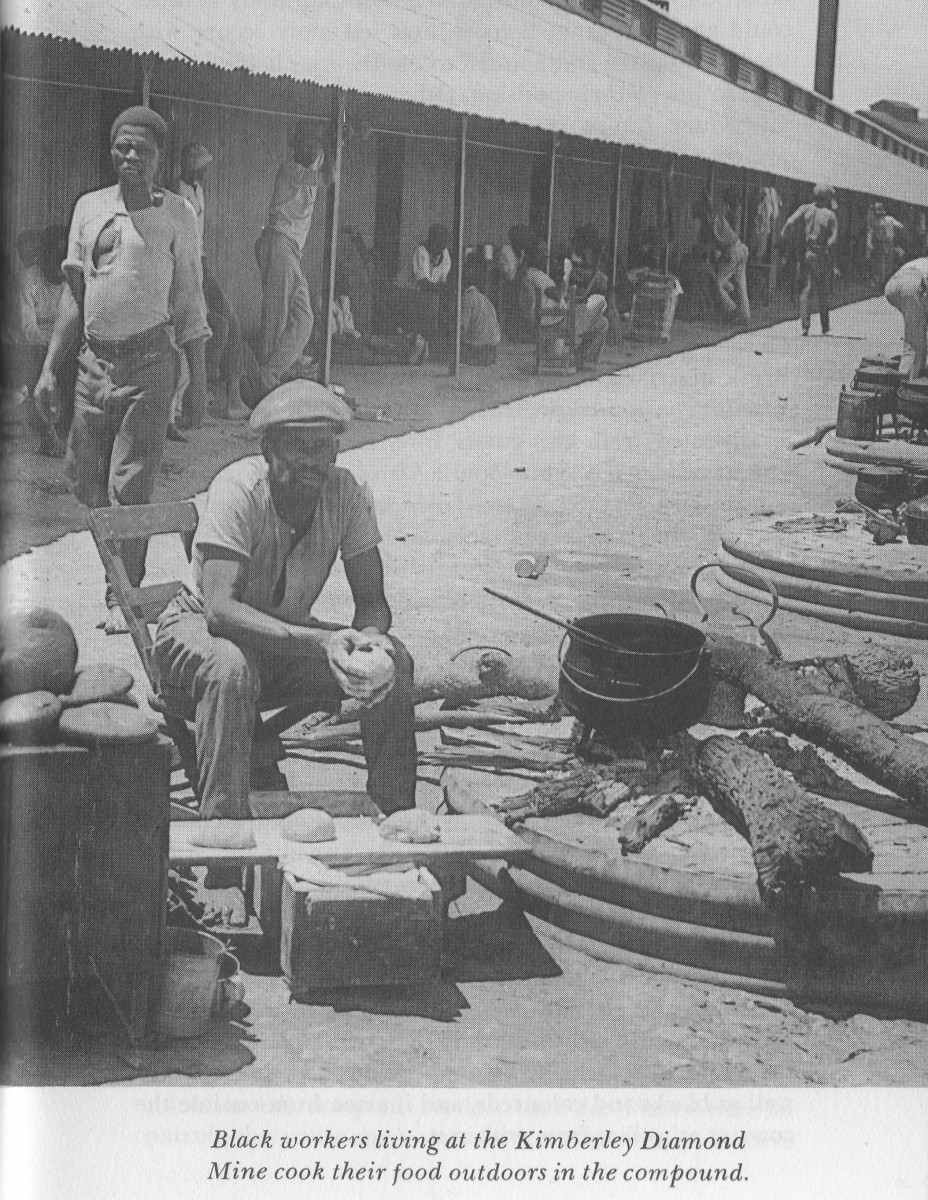 Miners cooking outside on the ground