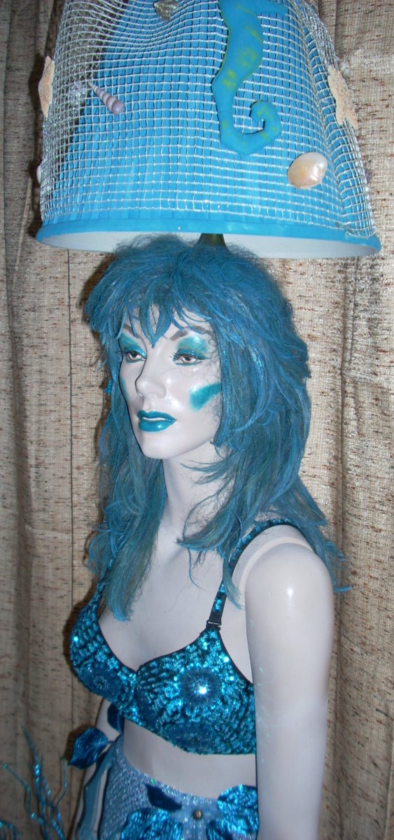 this is the full body mermaid lamp I created. I designed and made her tail/body portion.