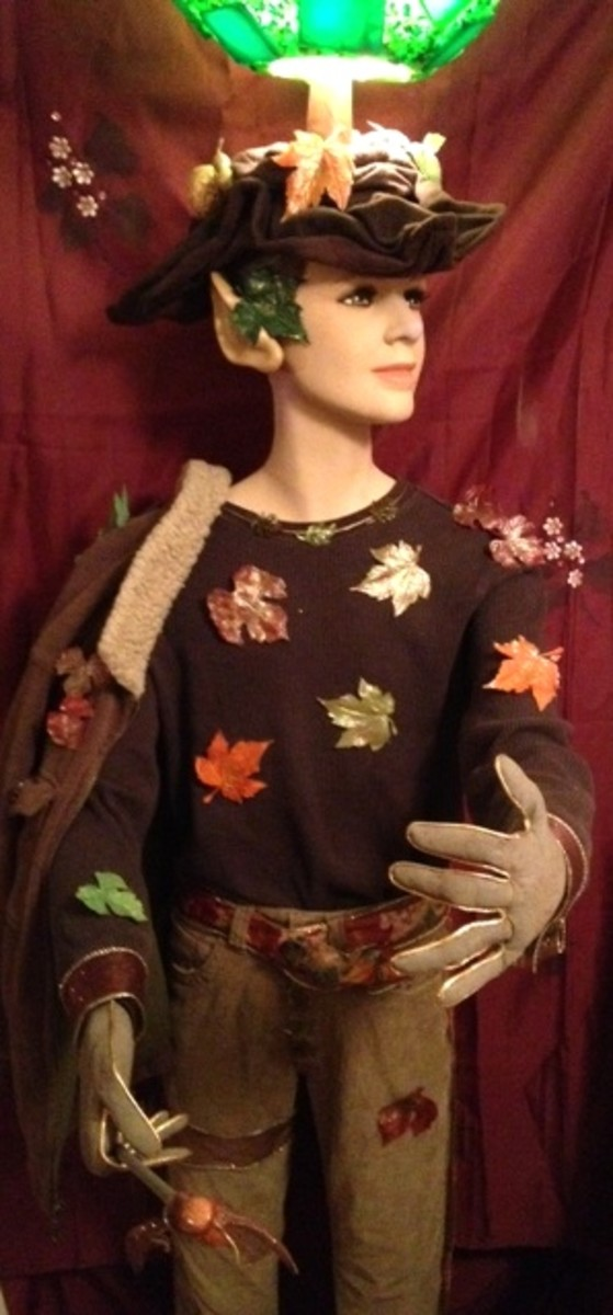 This is the Harvest Fall elf full body mannequin lamp. I made his gloves/hands with my primitive folk art design. Clothing has been repurposed.
