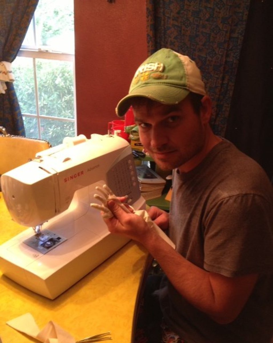 me sewing some clothing and working on the arms and hand portions.
