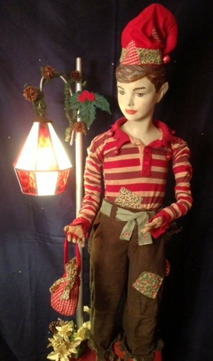 Here is the male Christmas Elf floor lamp. I married primitive folk art into the design.