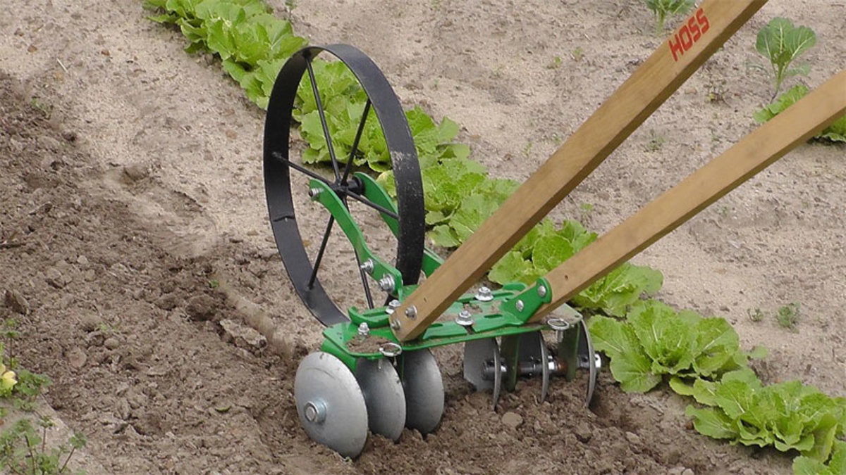 Hand push garden cultivators have different types of attachments.