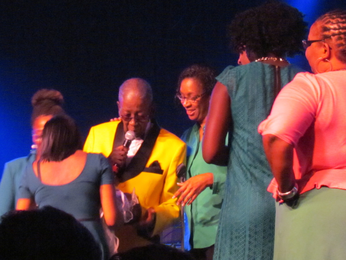 Blue Lovett, is joined on stage by his family, who thanked him for his love and support over the years.