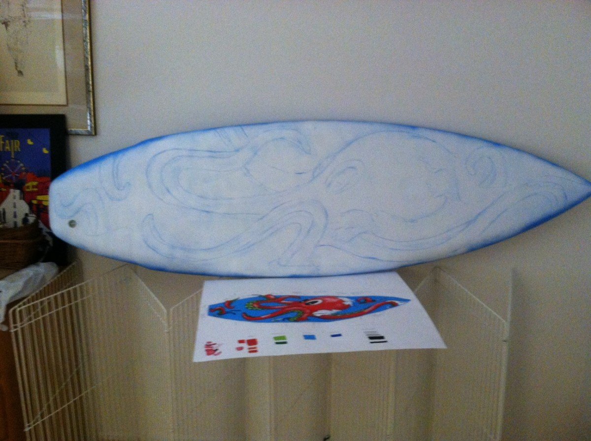 I used blue chalk to draw the design onto the board. Note that the back of the board has already been sprayed with ground (blue.)