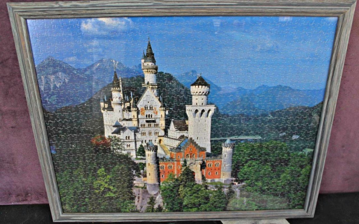 Beautiful framed 24 inches by 30 inches Ravensburger Jigsaw puzzle of Neuschanstein Castle in Germany