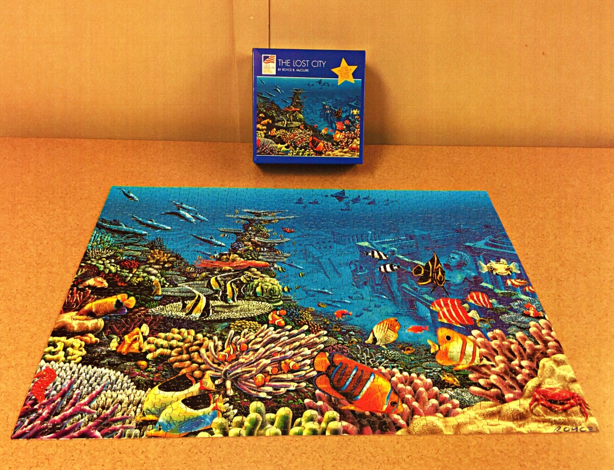"The Lost City by Royce B. McClure ... over 1,000 pieces ... Size 19 1/4"" x 26 5/8""  made by the Great American Puzzle Factory. Definitely a challenge but worth every minute. It has the most unique pieces I've seen so far."