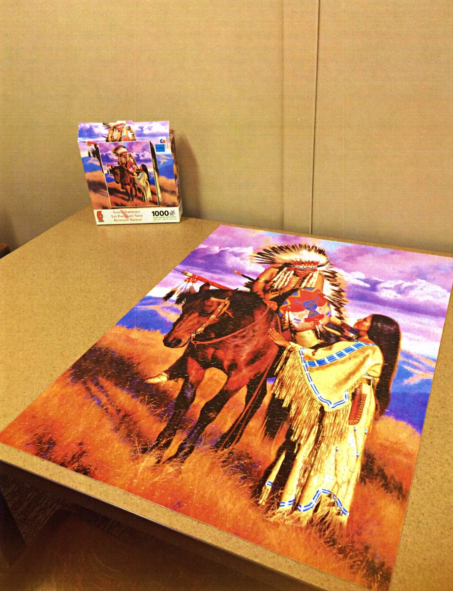 """Lovely American Indian Jigsaw Puzzle made by  Ceaco, The Farewell (Native Portraits) The Farewell is part of the Native American portrait 1000 piece jigsaw puzzle series by artist Alfredo Rodriguez. Puzzle measures 20"""" x 27"""" completed."""