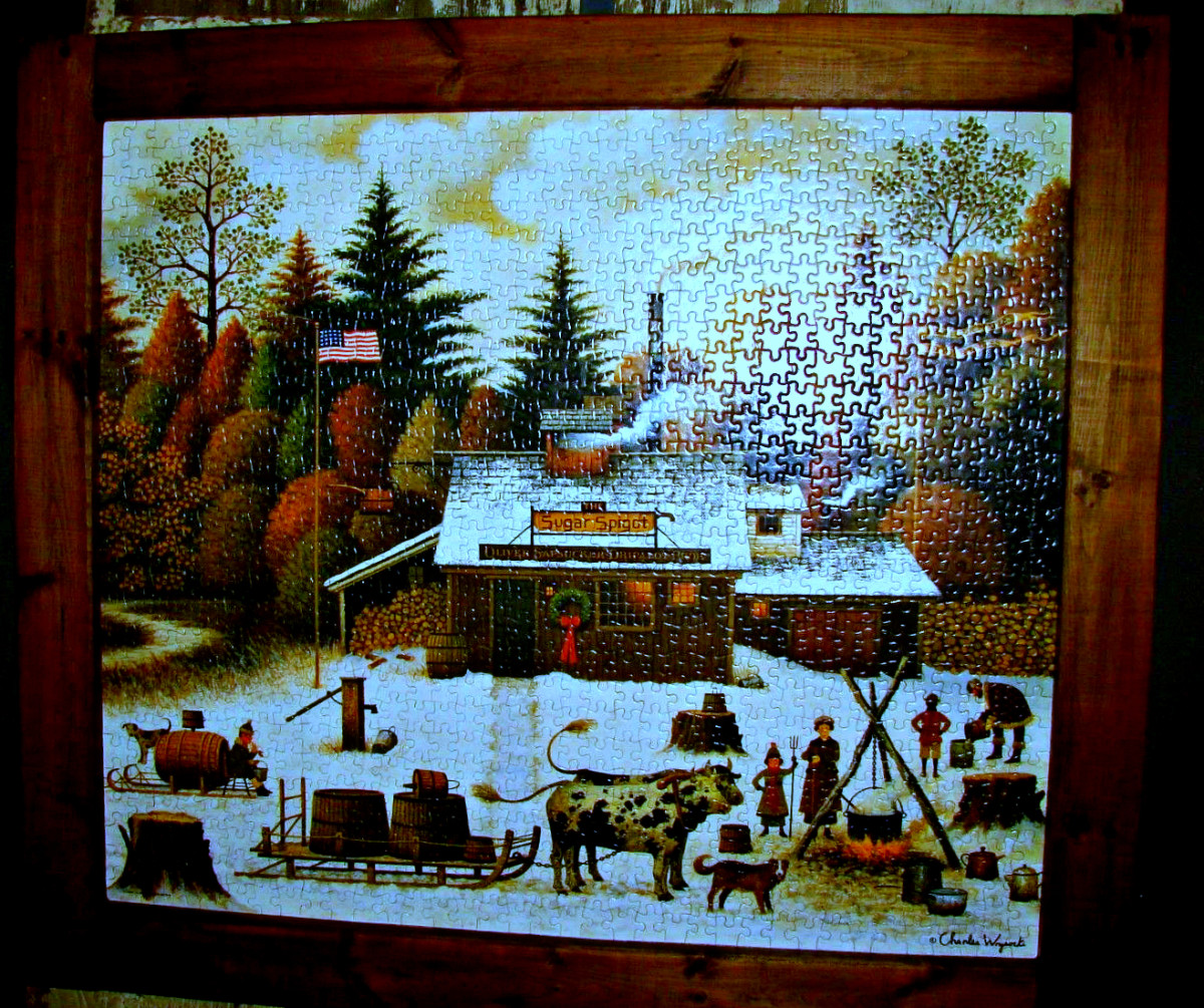 Here is an amazing finished piece of jigsaw puzzle art by Charles Wysocki. It is a awesome primitive folk art piece that is both Americana and Christmas all together in one fantastic scene.