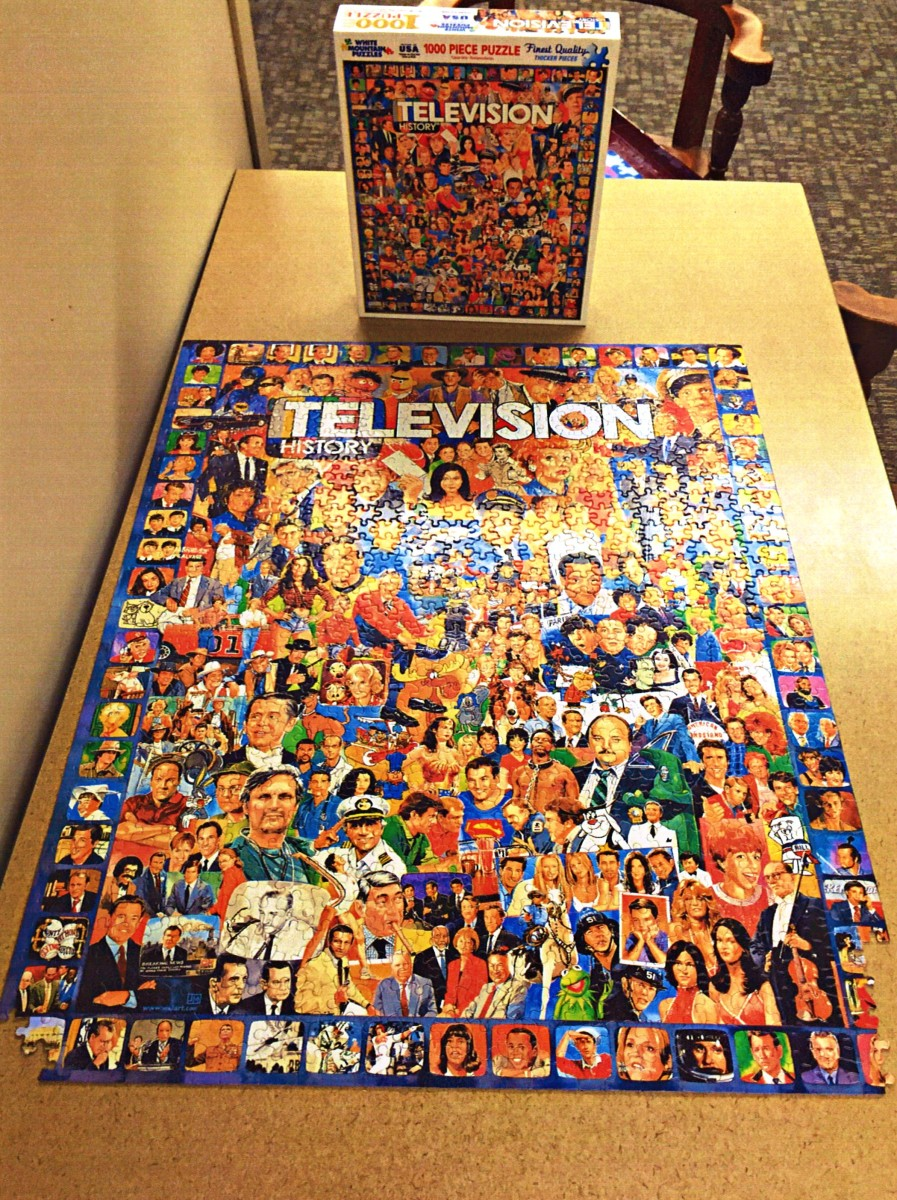Beautiful Television Puzzle 1000 Pieces, and almost finished. Made by White Mountain, and the theme is: Television History.