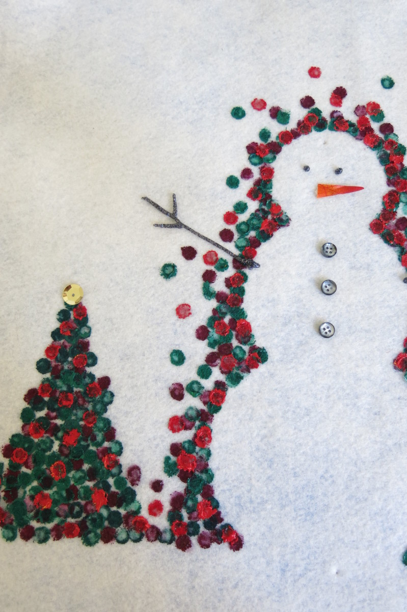 Finishing up your snowman design on your holiday pillow