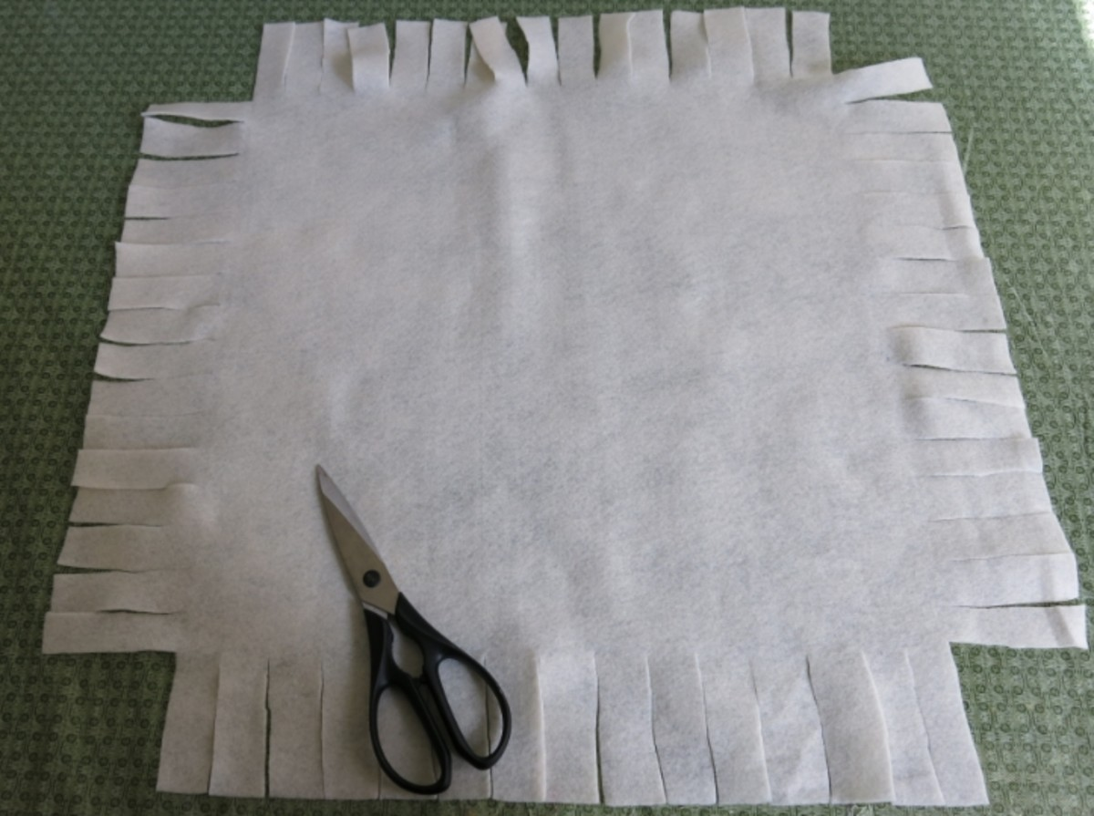 Cutting the fringe ties on your holiday pillow