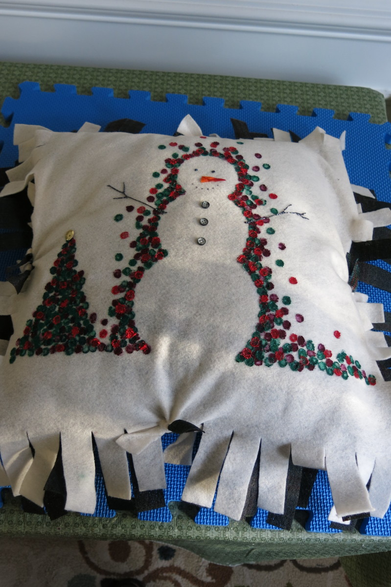 Putting together your no-sew holiday pillow